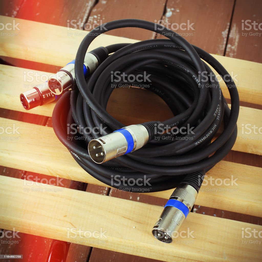 Music and sound - XLR microphone cable professional on a wooden...