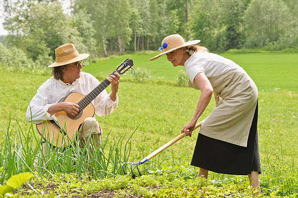 music and work in the vegetable garden stock photo