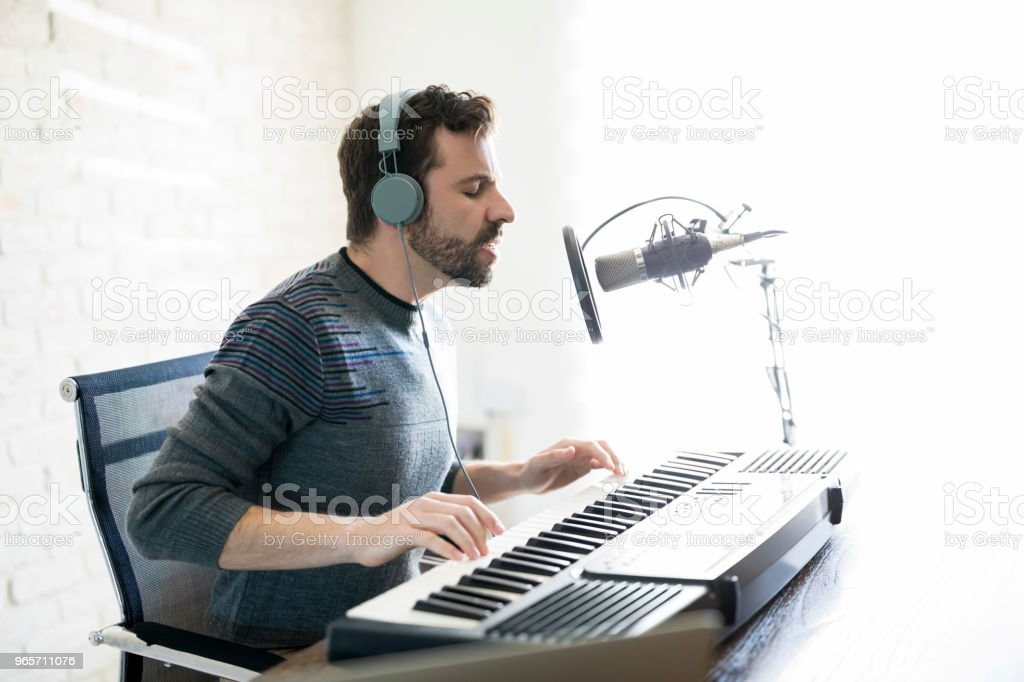 Music artist in a radio show - Royalty-free 30-39 Years Stock Photo