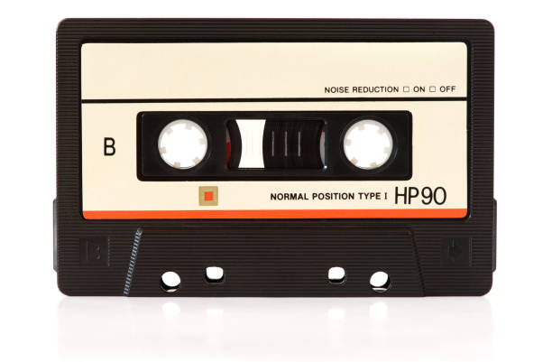 music audio tape music audio tape isolated on white background audio cassette stock pictures, royalty-free photos & images