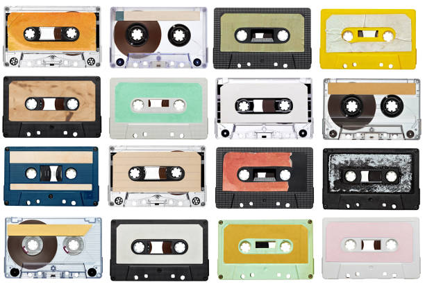 music audio tape vintage collection of various vintage audio tapes on white background. each one is shot separately audio cassette stock pictures, royalty-free photos & images