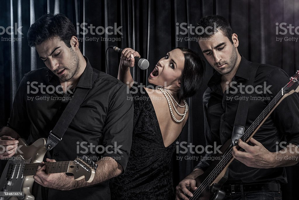 Music band performing live on stage royalty-free stock photo