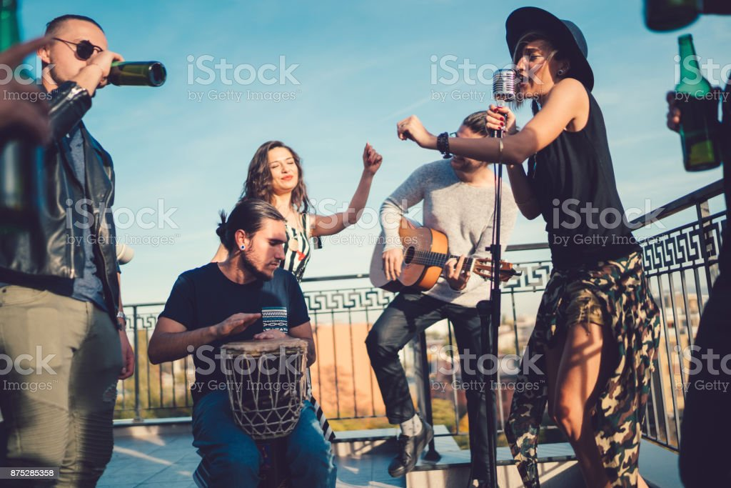 Music band performing on the rooftop stock photo