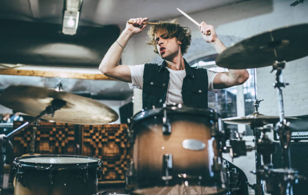 Music band repetition. Repetition of rock music band. Drummer behind the drum set. Rehearsal base drummer stock pictures, royalty-free photos & images