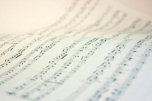 Very high key image of a music score.