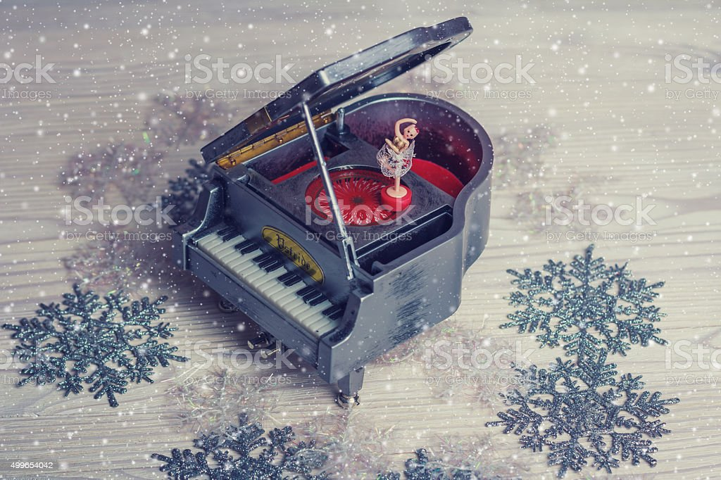 Music box with little ballerina on christmas background stock photo