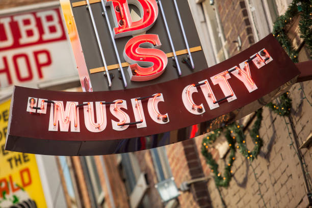 """Music city neon lights Nashville, Tennessee USA Nashville: Nashville is the capital of the U.S. state of Tennessee and home to Vanderbilt University. Legendary country music venues include the Grand Ole Opry House, home of the famous """"Grand Ole Opry"""" stage and radio show. The Country Music Hall of Fame and Museum and historic Ryman Auditorium are Downtown, as is the District, featuring honky-tonks with live music.  Nashvill is known as Music City. country and western music stock pictures, royalty-free photos & images"""