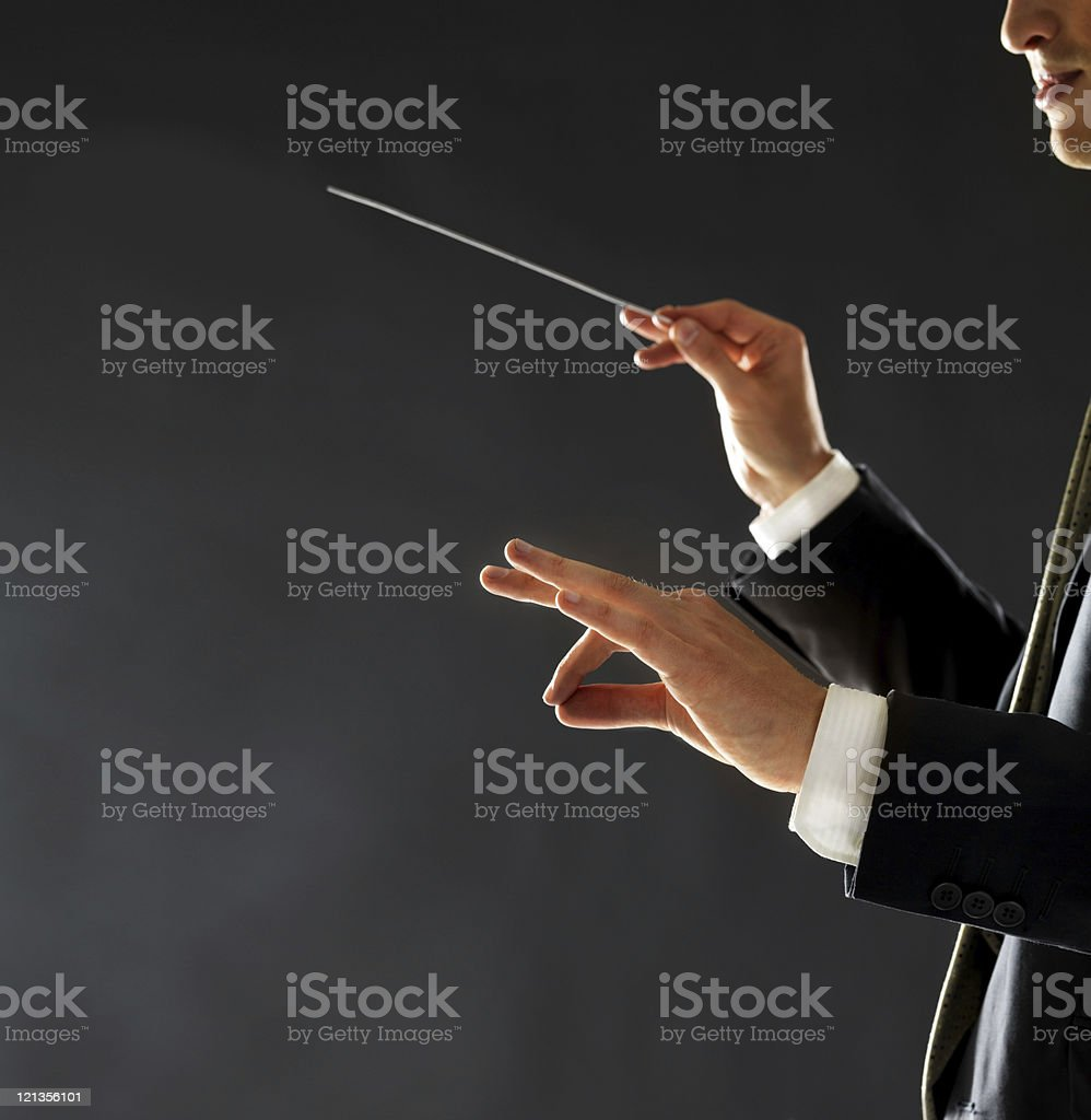 Music conductor - Man directing with his baton in concert stock photo