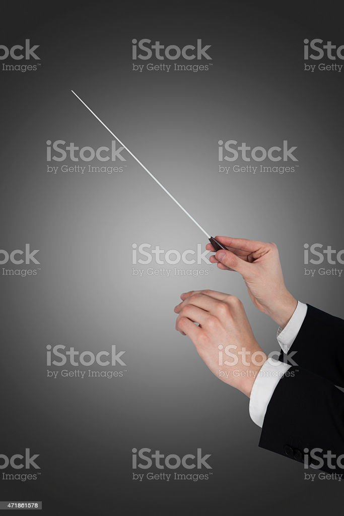 Music Conductor's Hands Holding Baton stock photo