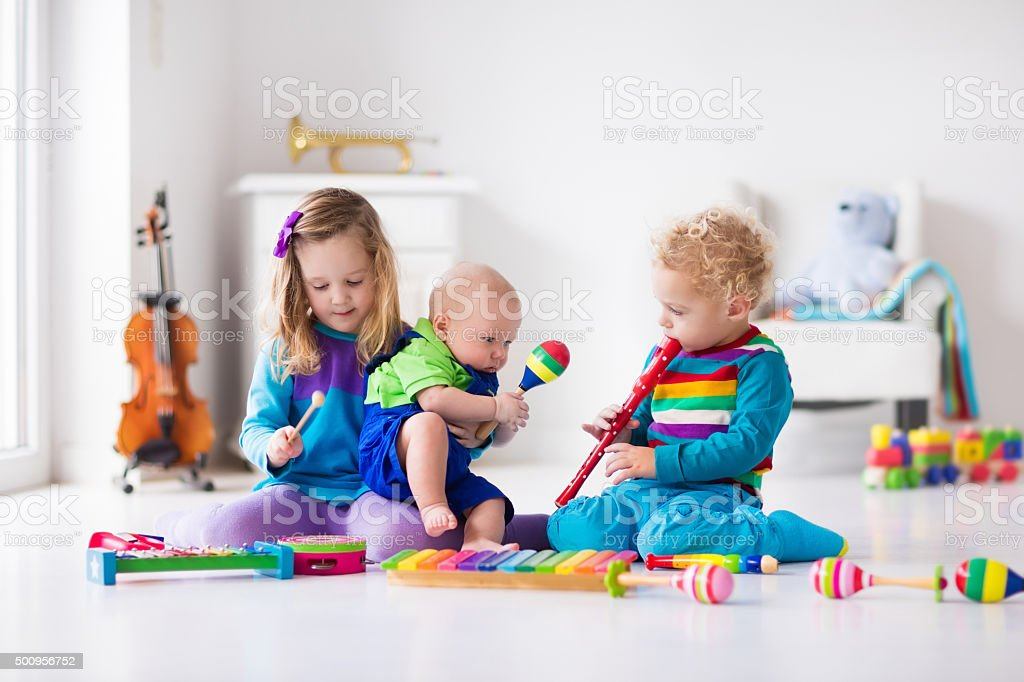 Music for kids, children with instruments stock photo