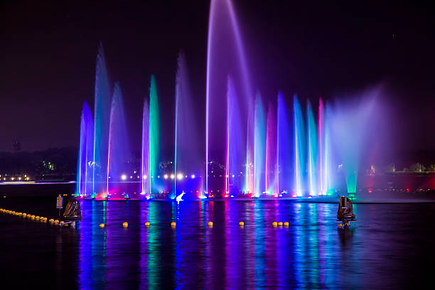 music fountain at night - competition group stock photos and pictures