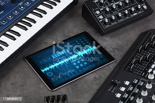 istock Music instruments and tablet with recording app 1158580072
