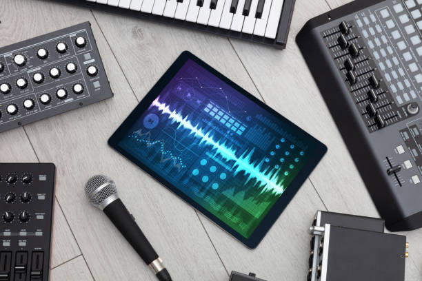 Music instruments and tablet with recording app stock photo