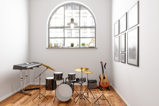 Music Instruments With Midi Keyboard, Guitar, Trumpet And Drum In The Room