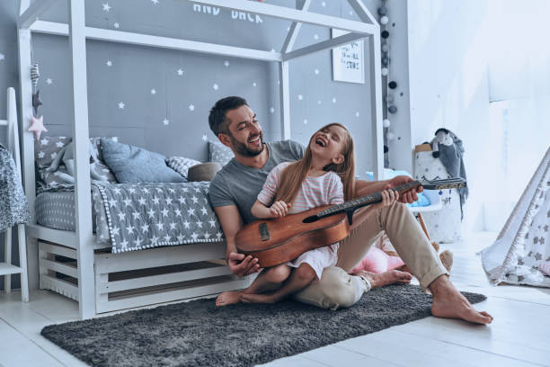 music is so much fun. - family room stock photos and pictures