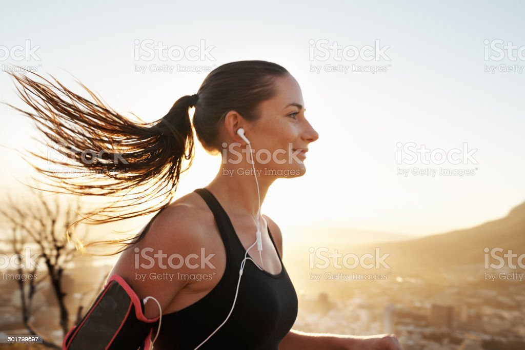 Music is the only motivation she needs stock photo