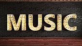 Music Light Bulb Sign Against Brick Wall