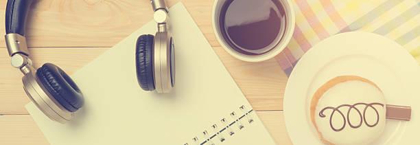music listening on coffee break on vintage toning. - musik kuchen stock-fotos und bilder