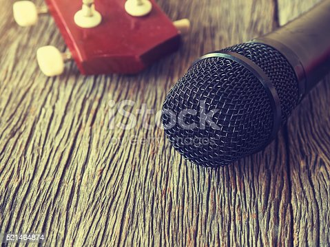istock Music lover concept. A Black microphone on wooden plate. 521464874