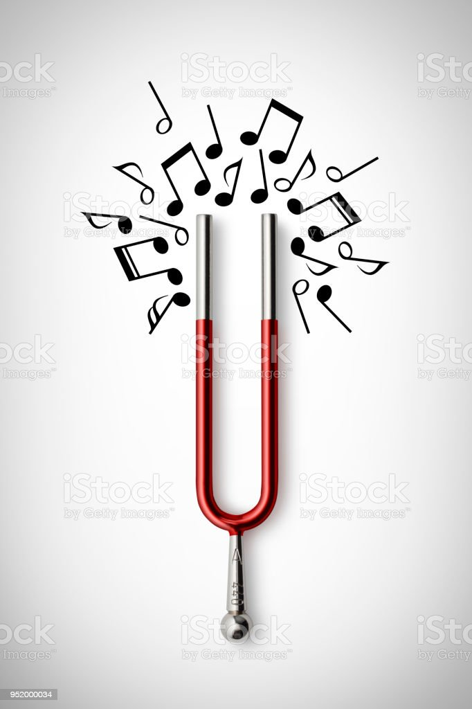 Music. Magnetic tuning fork attracting musical notes. Concept photography. stock photo