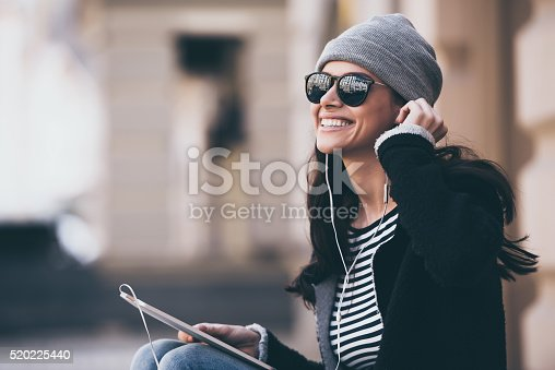istock Music makes her day. 520225440