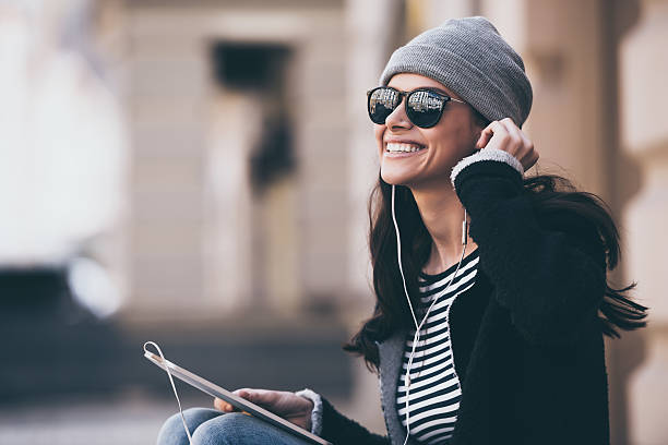 music makes her day. - urban fashion stock photos and pictures