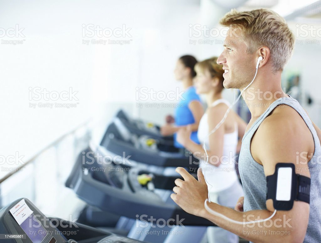Music makes jogging effortless royalty-free stock photo