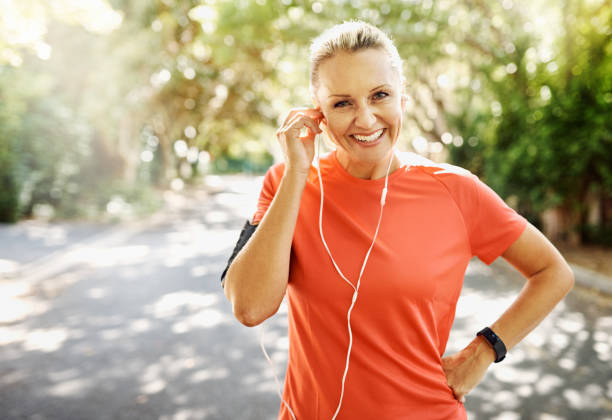 Music makes the road seem shorter Cropped shot of a mature woman out for her morning run only mature women stock pictures, royalty-free photos & images