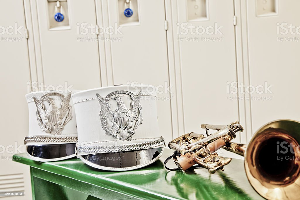 Music: Marching band hat, trumpet in school locker room. royalty-free stock photo