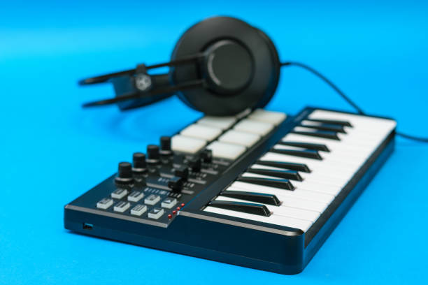 Music mixer and headphones on blue background. stock photo