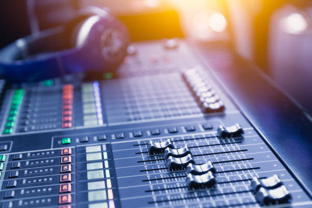 music mixer sound recording engineer control desk for dj at stage show. - radio dj stock photos and pictures