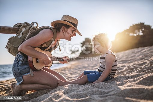656711080 istock photo Music moments at the beach 1090378090