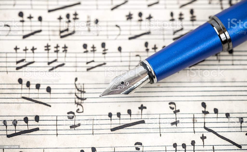 Music notes and fountain pen. royalty-free stock photo