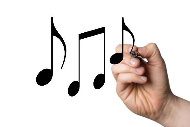 notas musicais atraídos por uma mão - desenhos de notas musicais - fotografias e filmes do acervo