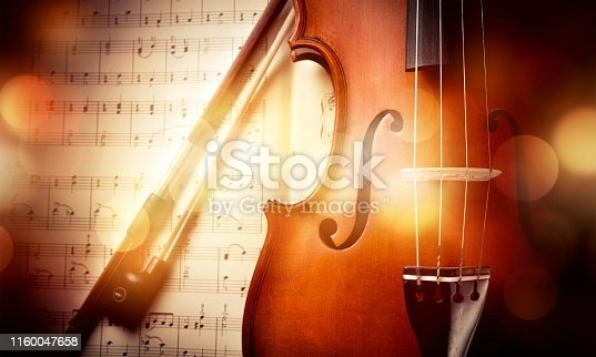 Close-up Photo Of Violin And Musical Notes