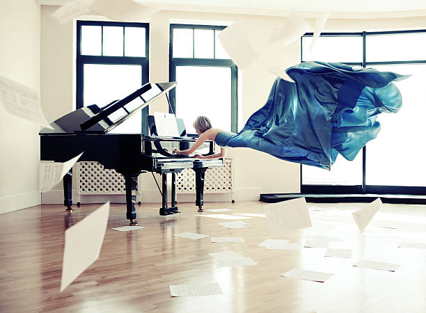 Music Surreal picture of a pianist pianist stock pictures, royalty-free photos & images