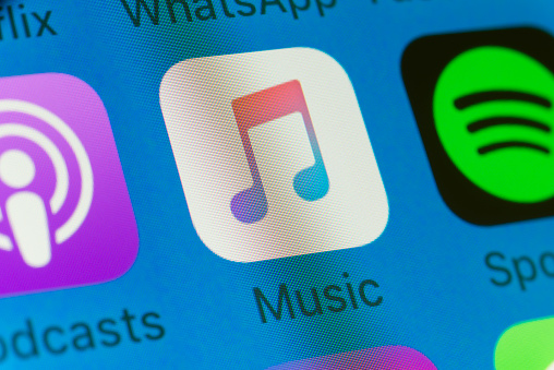Music, Podcasts, Soptify and other cellphone Apps on iPhone screen