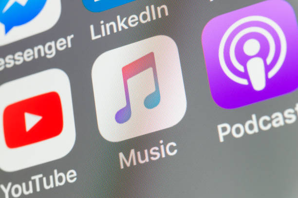 Music, Podcasts, Youtube and other cellphone Apps on iPhone screen stock photo