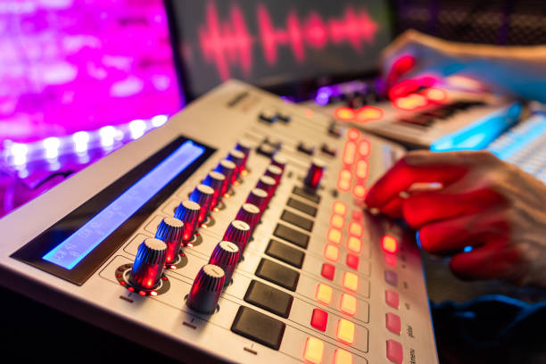 DJ, music producer hands editing on digital remixing controller equipment in sound studio DJ, music producer hands editing on digital remixing controller equipment in sound studio, focus on knobs electronic music stock pictures, royalty-free photos & images