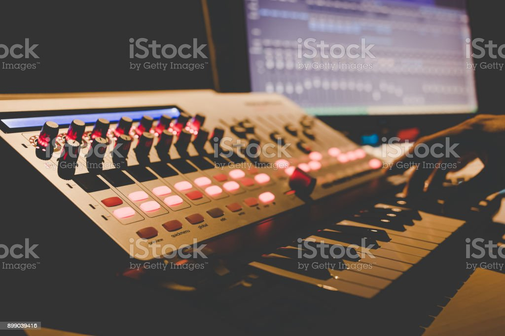 Music Producer Hands Playing Midi Keyboard Synthesizer In Recording