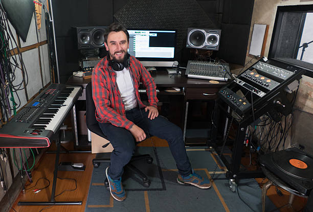 Music producer working at a recording studio stock photo