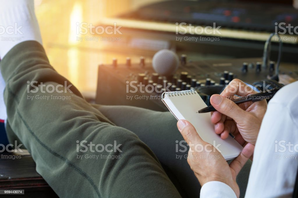 Music producer working in home recording studio. stock photo