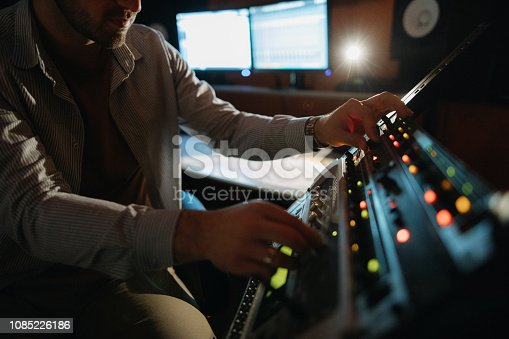 Photo of music producer working in recording studio