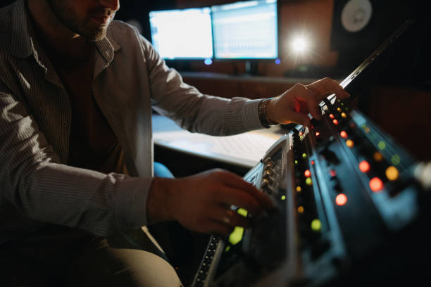 Music producer working in recording studio Photo of music producer working in recording studio producer stock pictures, royalty-free photos & images