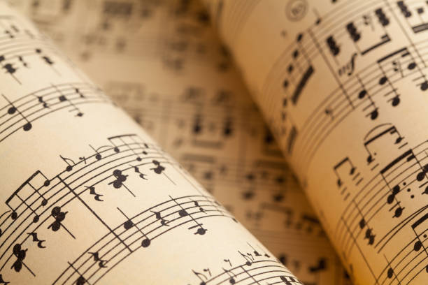 Music Rolls Several Music Sheets in a Rolled Pile. sheet music stock pictures, royalty-free photos & images