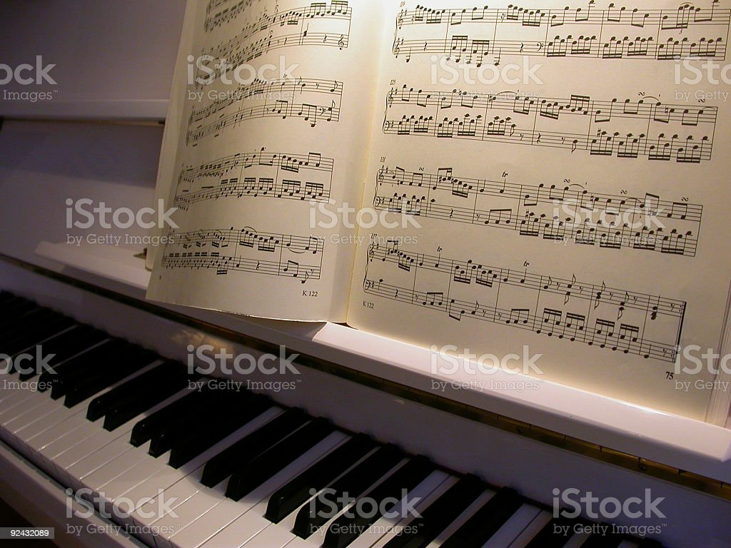 music sheets on a white piano stock photo