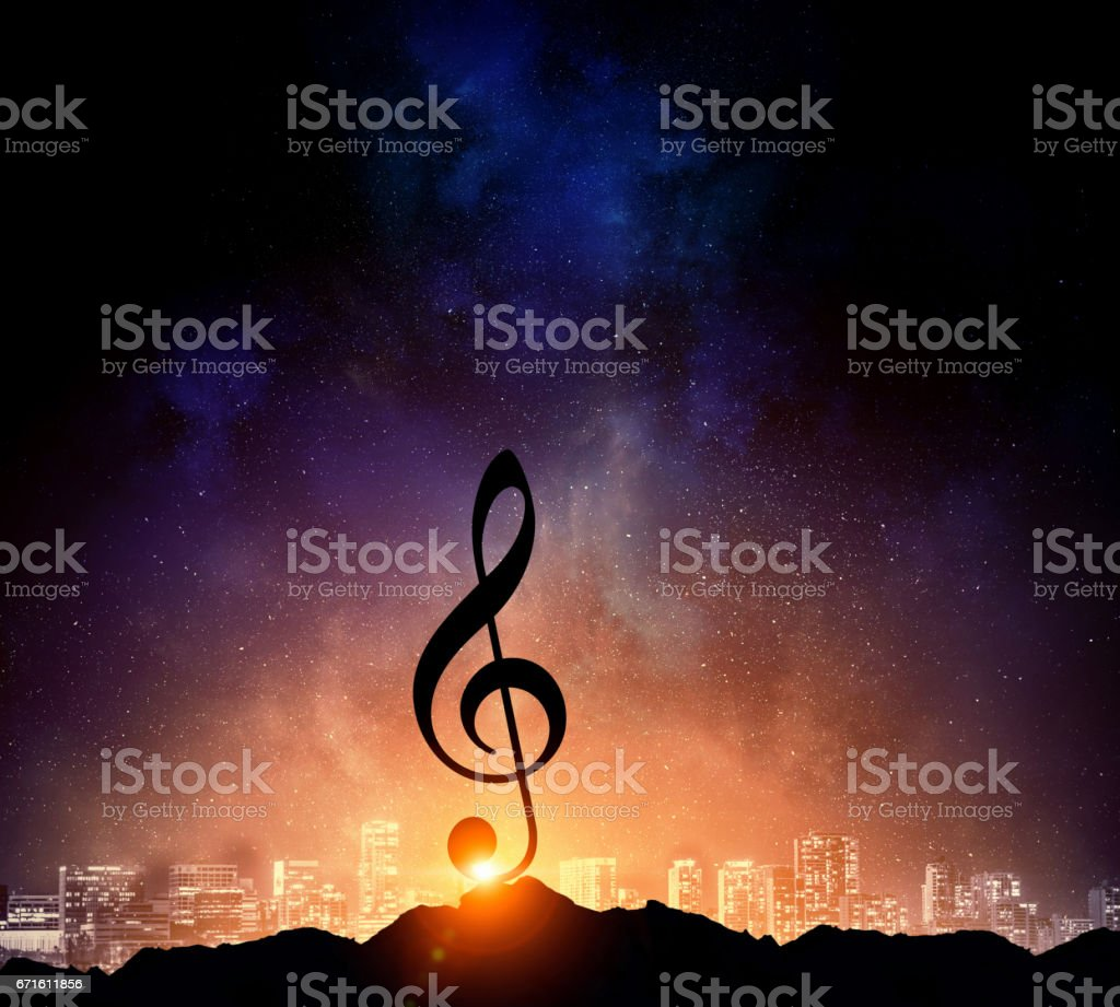 Music sign in darkness. Mixed media . Mixed media stock photo