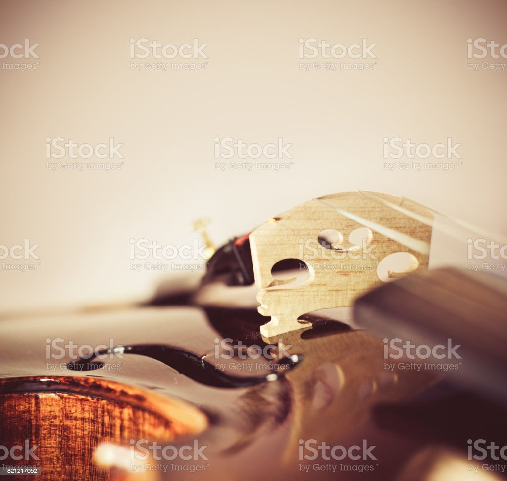 musical background with violin bridge close-up stock photo