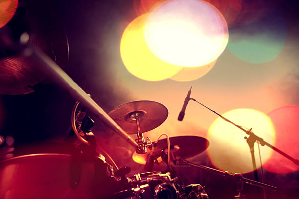 Musical background.Drumkit on stage lights performance Live music.Concert and band on stage.Festival and show background drum kit stock pictures, royalty-free photos & images
