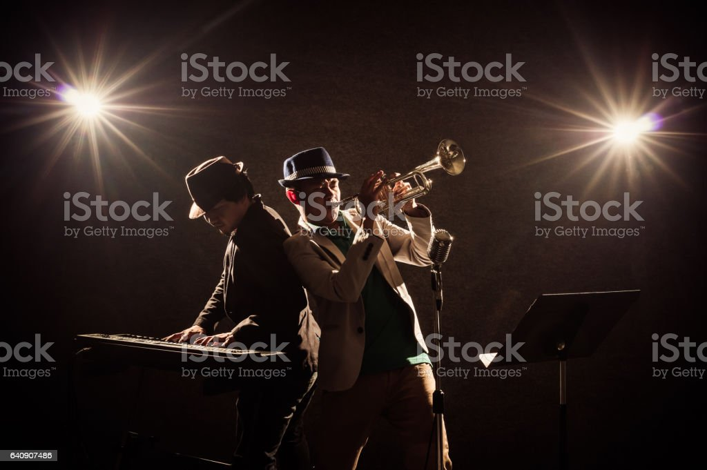 musical concept, Musicians playing a Trumpet and keyboard stock photo